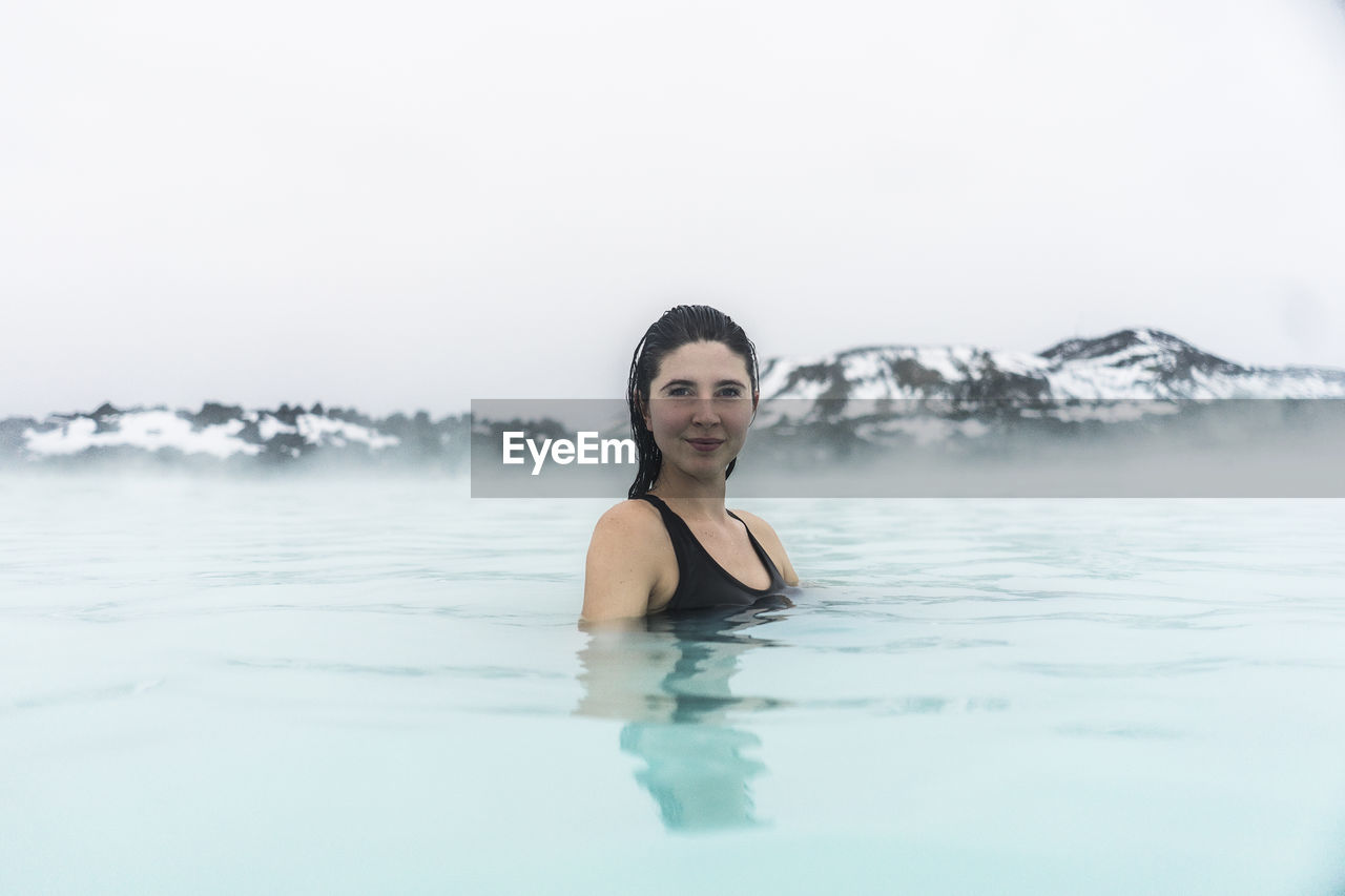 Portrait Of Smiling Young Woman In Hot Spring
