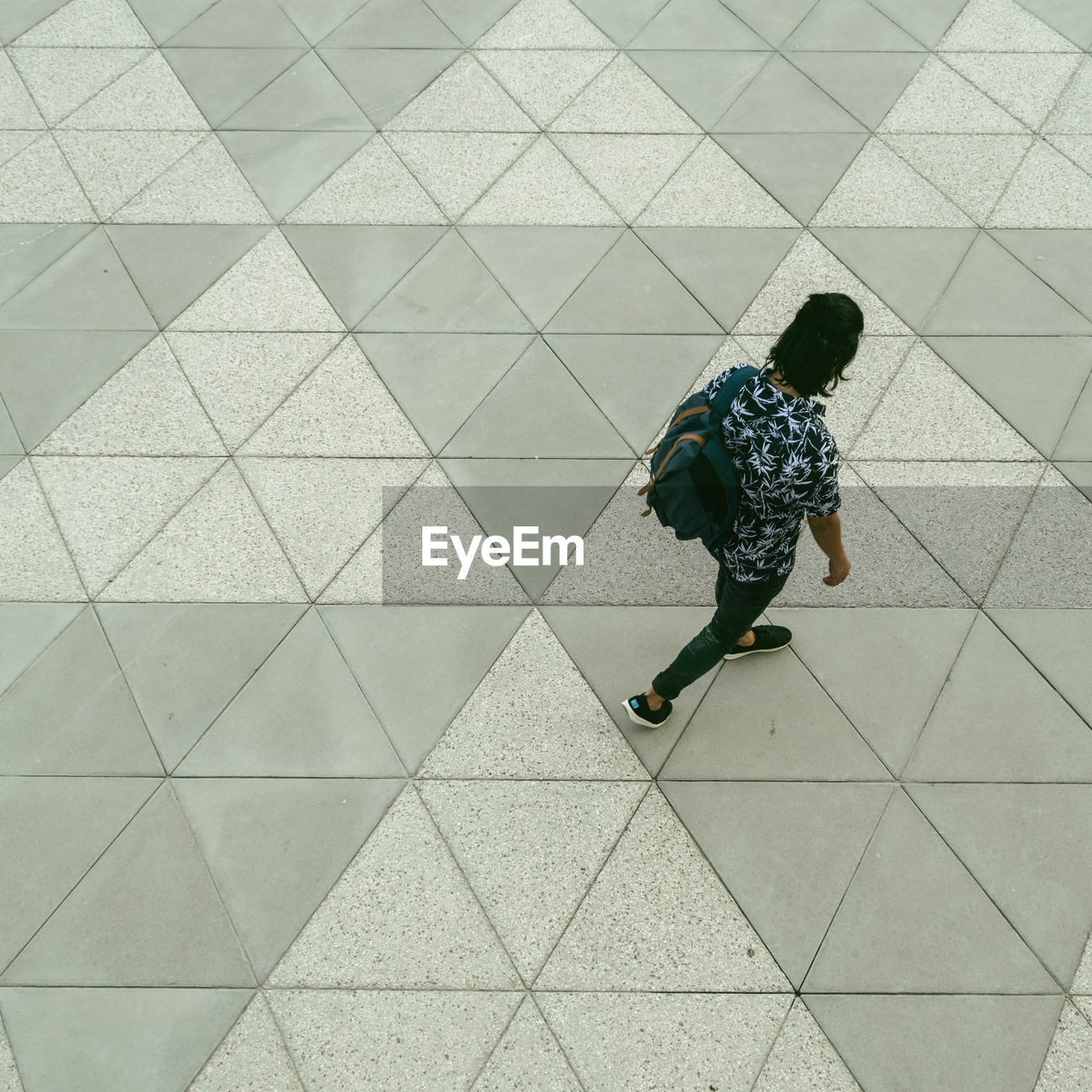 HIGH ANGLE VIEW OF TWO PEOPLE WALKING ON FOOTPATH