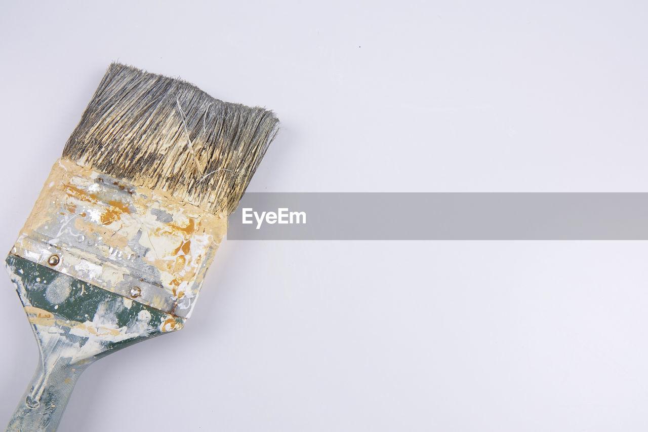 Close-up of paintbrush against white background