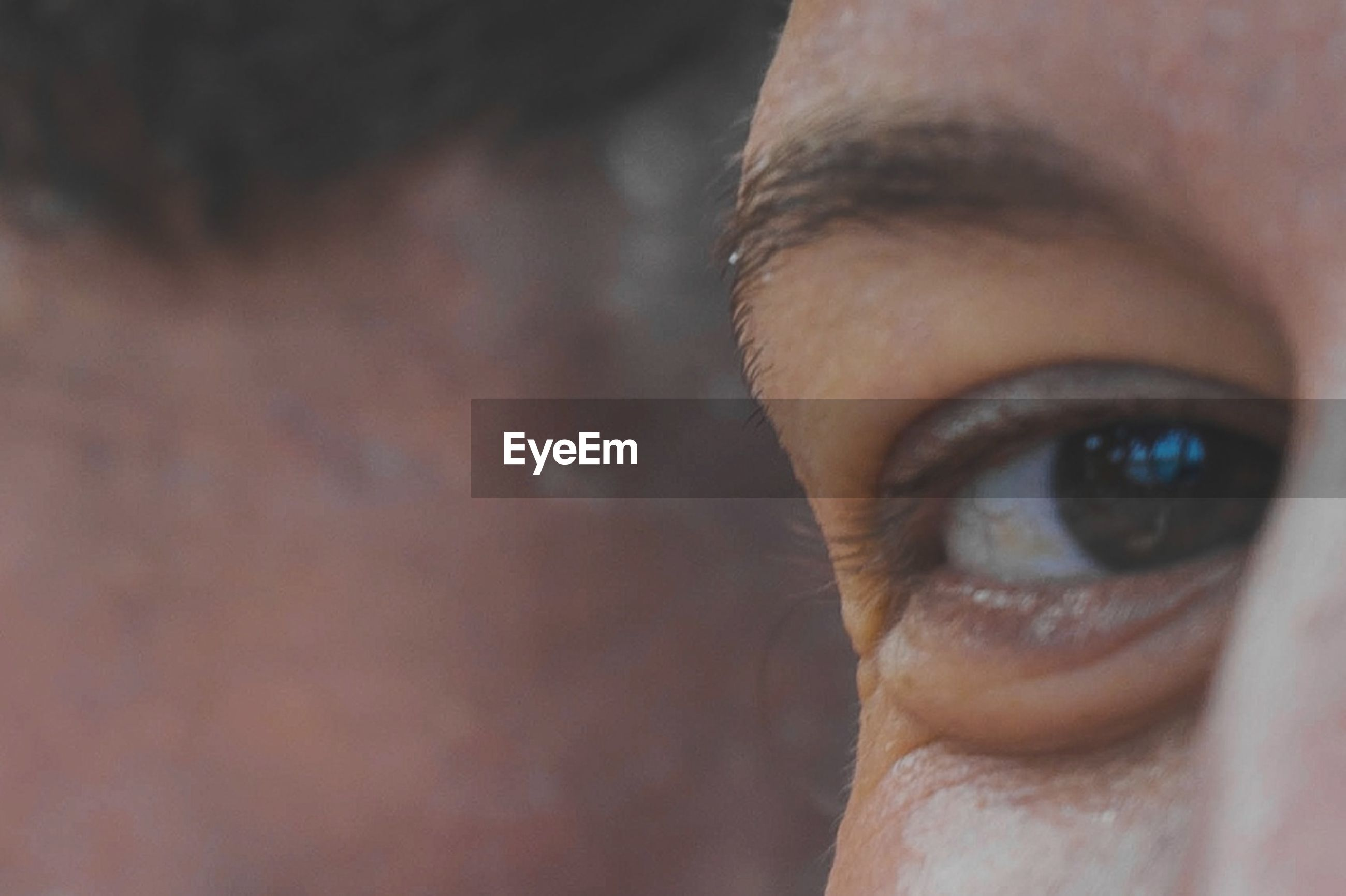 human eye, human body part, one person, eyelash, real people, close-up, sensory perception, human skin, portrait, looking at camera, eyesight, eyeball, human face, day, outdoors, people