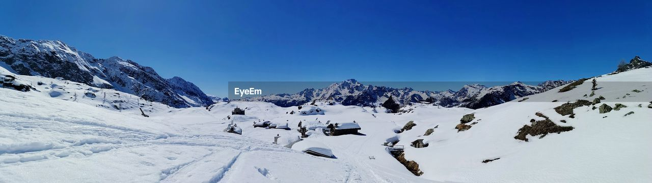 cold temperature, winter, snow, sky, beauty in nature, scenics - nature, mountain, blue, white color, tranquility, clear sky, mountain range, tranquil scene, nature, environment, snowcapped mountain, non-urban scene, landscape, covering, extreme weather
