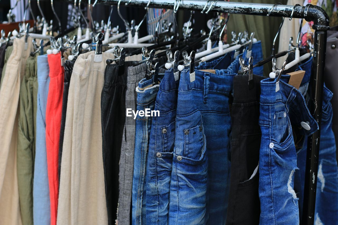 Close-Up Of Clothes Hanging In Store