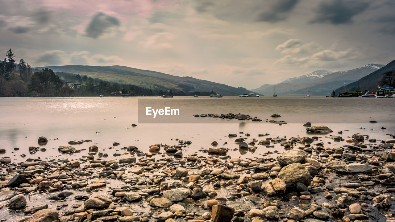 water, sky, cloud - sky, beauty in nature, tranquil scene, scenics - nature, tranquility, mountain, rock, solid, nature, rock - object, no people, beach, lake, non-urban scene, idyllic, land