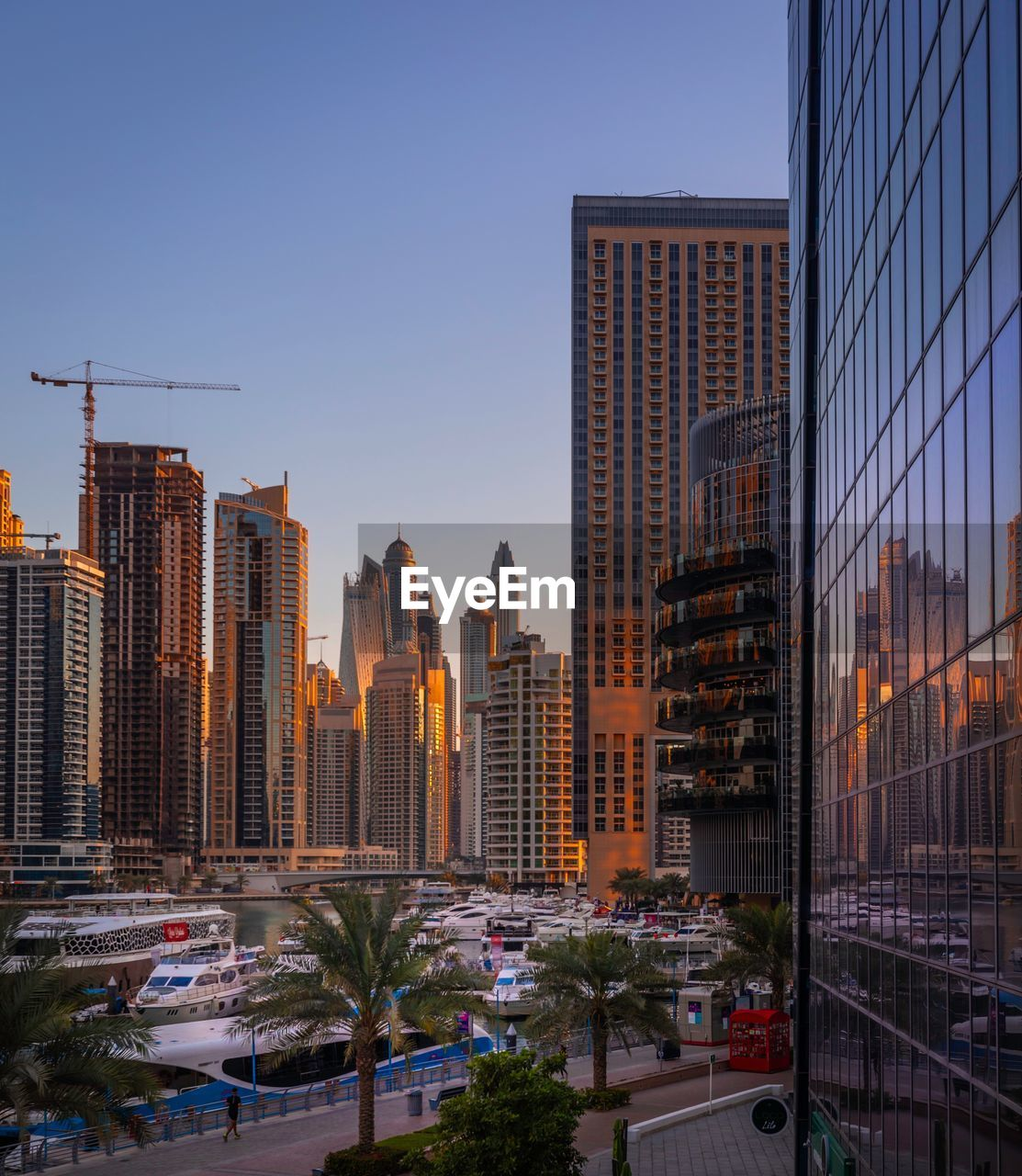 building exterior, architecture, city, built structure, building, office building exterior, sky, modern, skyscraper, tall - high, office, tower, cityscape, urban skyline, transportation, nature, clear sky, landscape, city life, no people, outdoors, financial district
