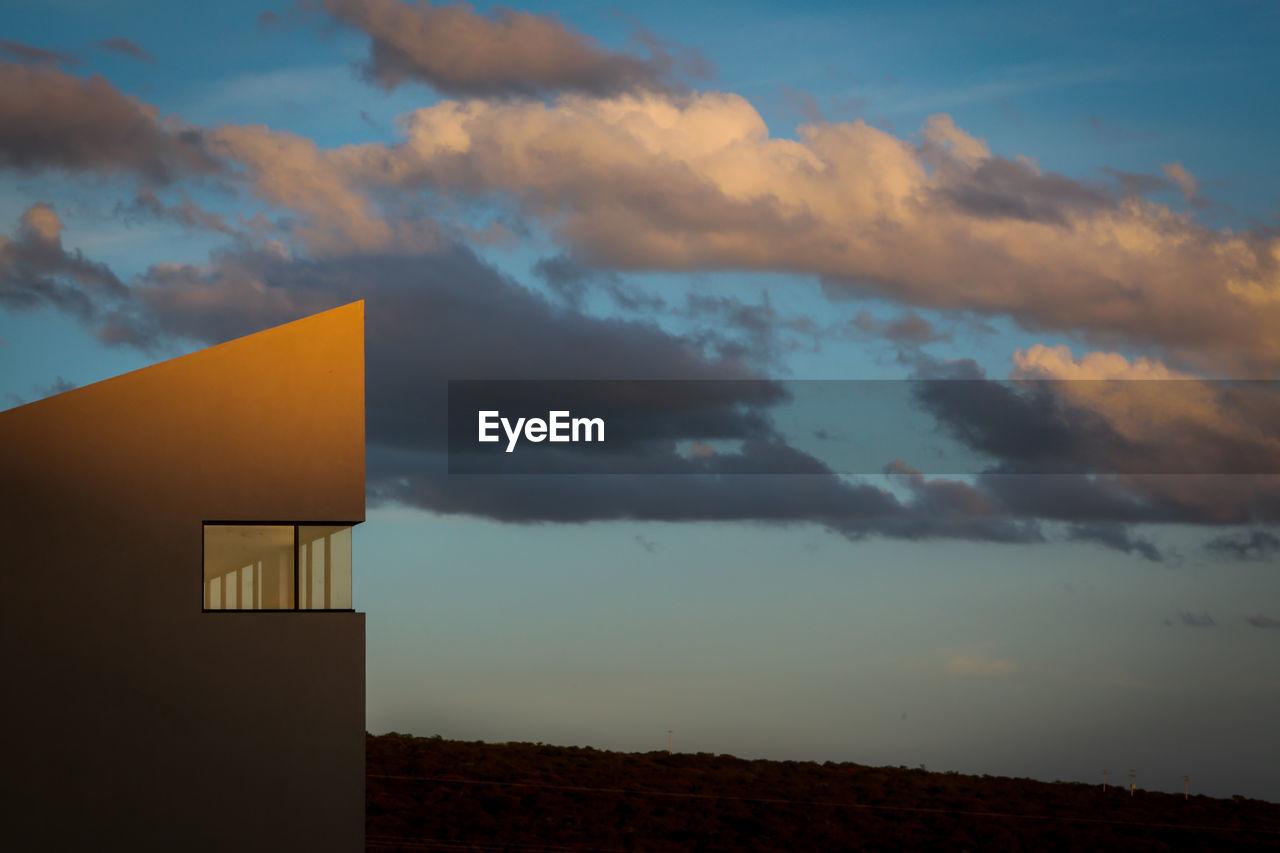cloud - sky, sky, architecture, built structure, sunset, nature, beauty in nature, building exterior, no people, scenics - nature, building, orange color, environment, outdoors, land, landscape, dusk, house, field, ominous