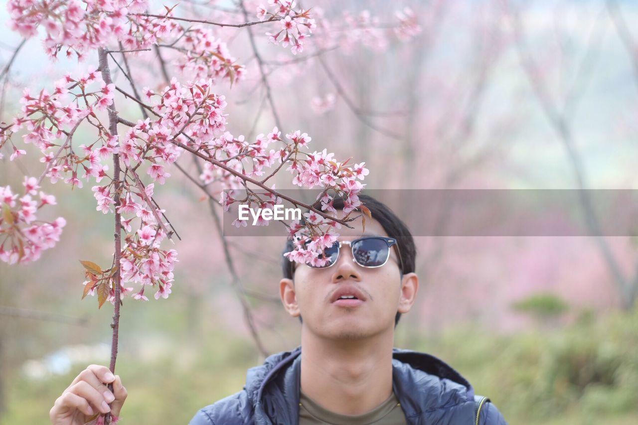 Man Wearing Sunglasses And Flower Tree