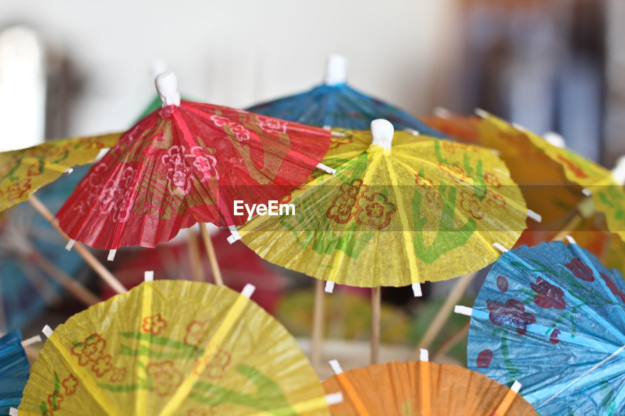 umbrella, focus on foreground, close-up, protection, no people, security, selective focus, wet, day, nature, hand fan, multi colored, outdoors, still life, rain, water, creativity, choice, leaf