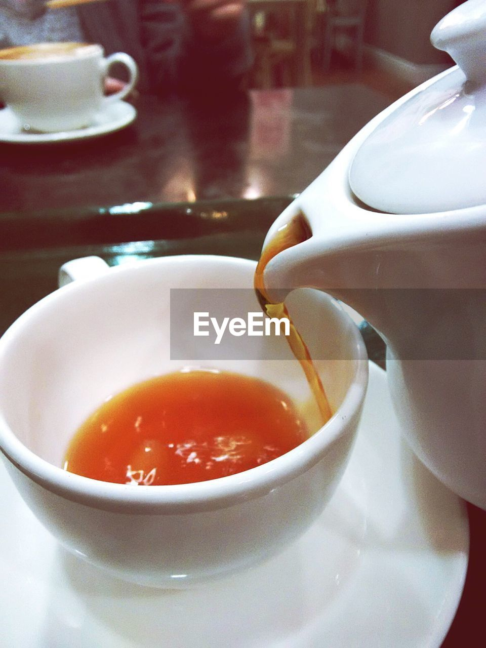 CLOSE-UP OF TEA CUP IN BOWL