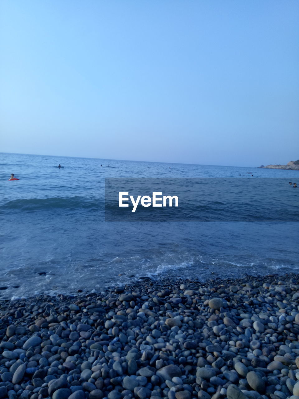 pebble, sea, pebble beach, beach, shore, nature, beauty in nature, water, tranquil scene, clear sky, horizon over water, outdoors, surface level, scenics, tranquility, day, no people, blue, sky