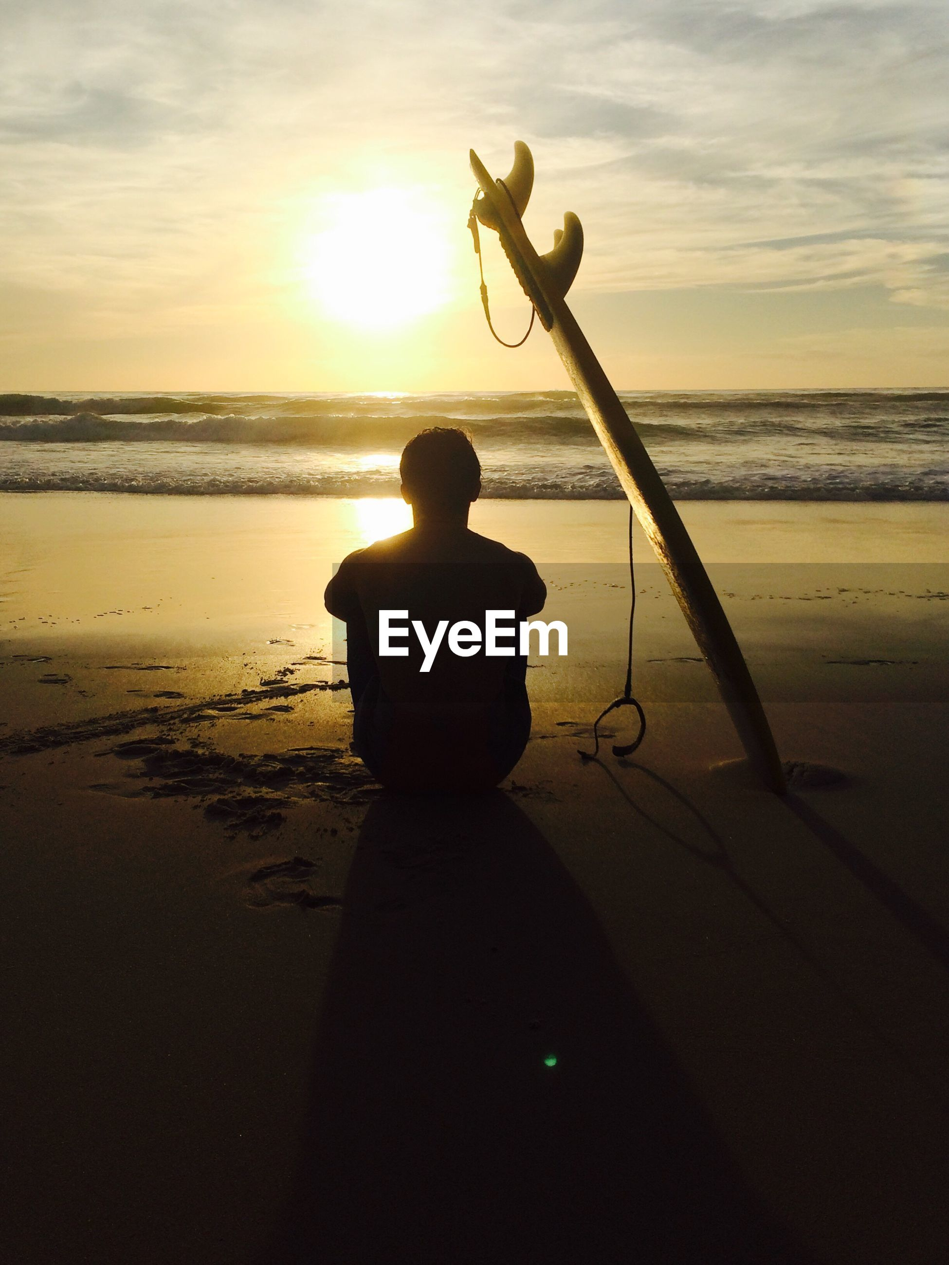 sunset, sea, water, one person, silhouette, nature, horizon over water, real people, beauty in nature, standing, scenics, beach, sky, sun, men, rear view, leisure activity, outdoors, holding, tranquil scene, tranquility, fishing, full length, sand, lifestyles, childhood, fishing pole, day, people