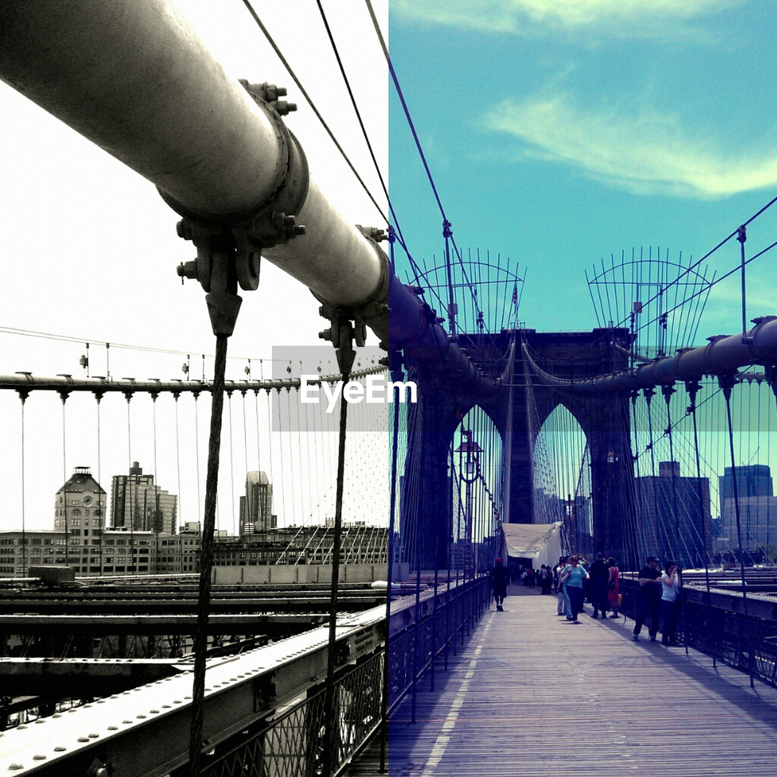 Digital composite image of people walking on suspension bridge