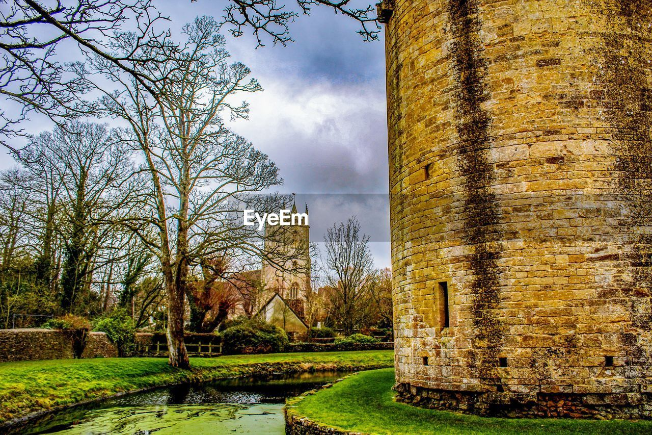 sky, tree, plant, architecture, nature, no people, built structure, cloud - sky, day, outdoors, building exterior, water, grass, land, growth, beauty in nature, old, field, building