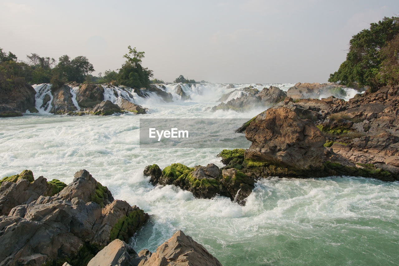 water, waterfall, nature, motion, rock - object, beauty in nature, scenics, long exposure, rock, power in nature, no people, sea, day, outdoors, wave, clear sky, tree, sky, force