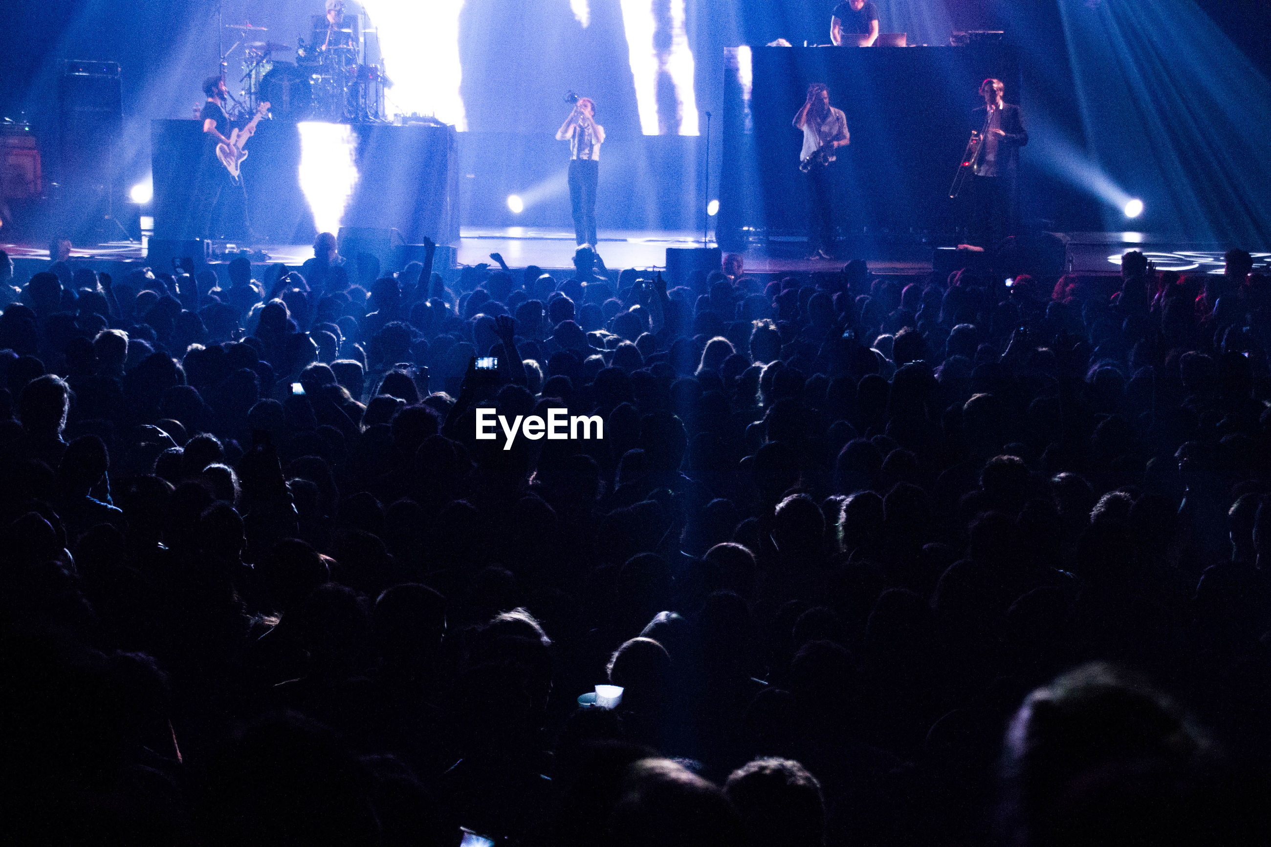 large group of people, indoors, crowd, illuminated, night, nightlife, men, music, concert, lifestyles, person, arts culture and entertainment, popular music concert, music festival, togetherness, leisure activity, silhouette, enjoyment, light - natural phenomenon