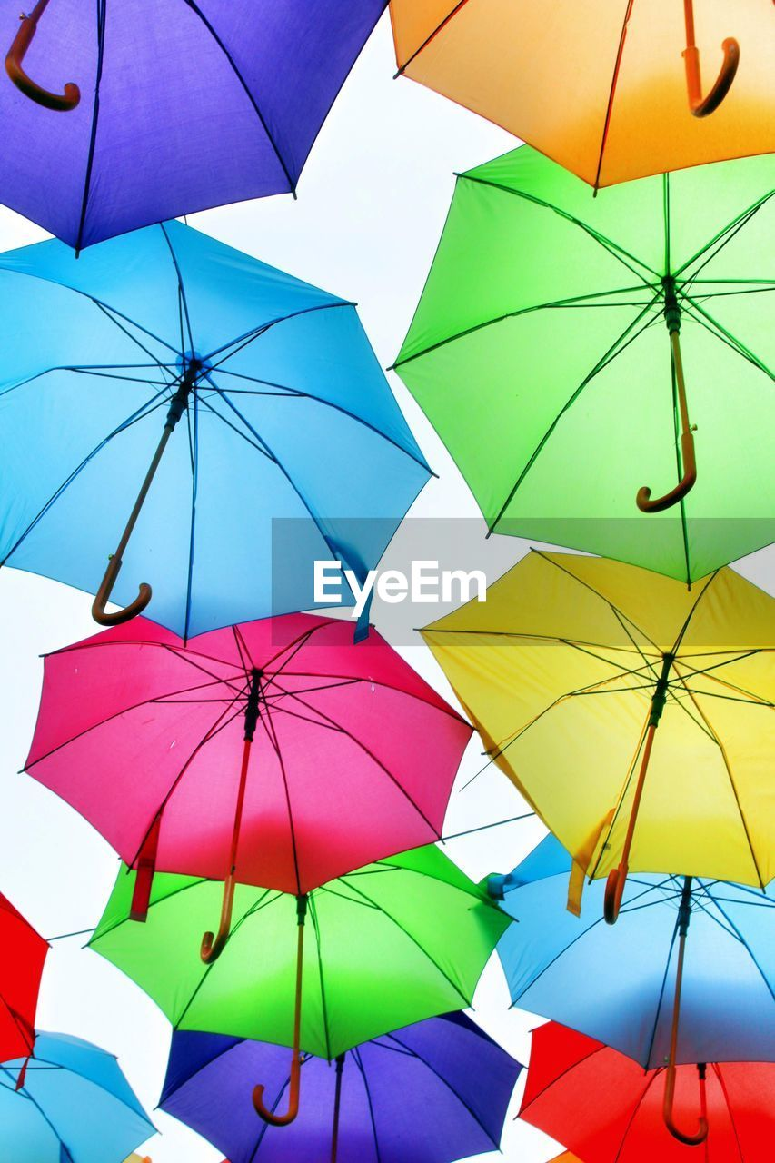 protection, umbrella, security, multi colored, safety, choice, low angle view, variation, large group of objects, no people, full frame, day, hanging, backgrounds, rain, abundance, wet, group of objects, close-up, outdoors, sheltering