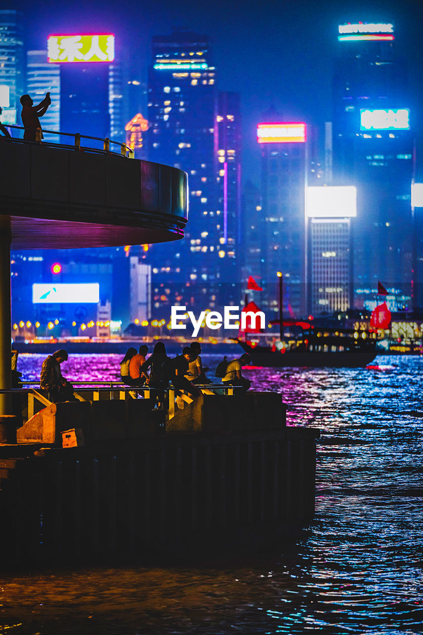 illuminated, water, architecture, city, night, building exterior, built structure, waterfront, building, multi colored, incidental people, transportation, street, nature, outdoors, real people, reflection, lighting equipment, nautical vessel, nightlife