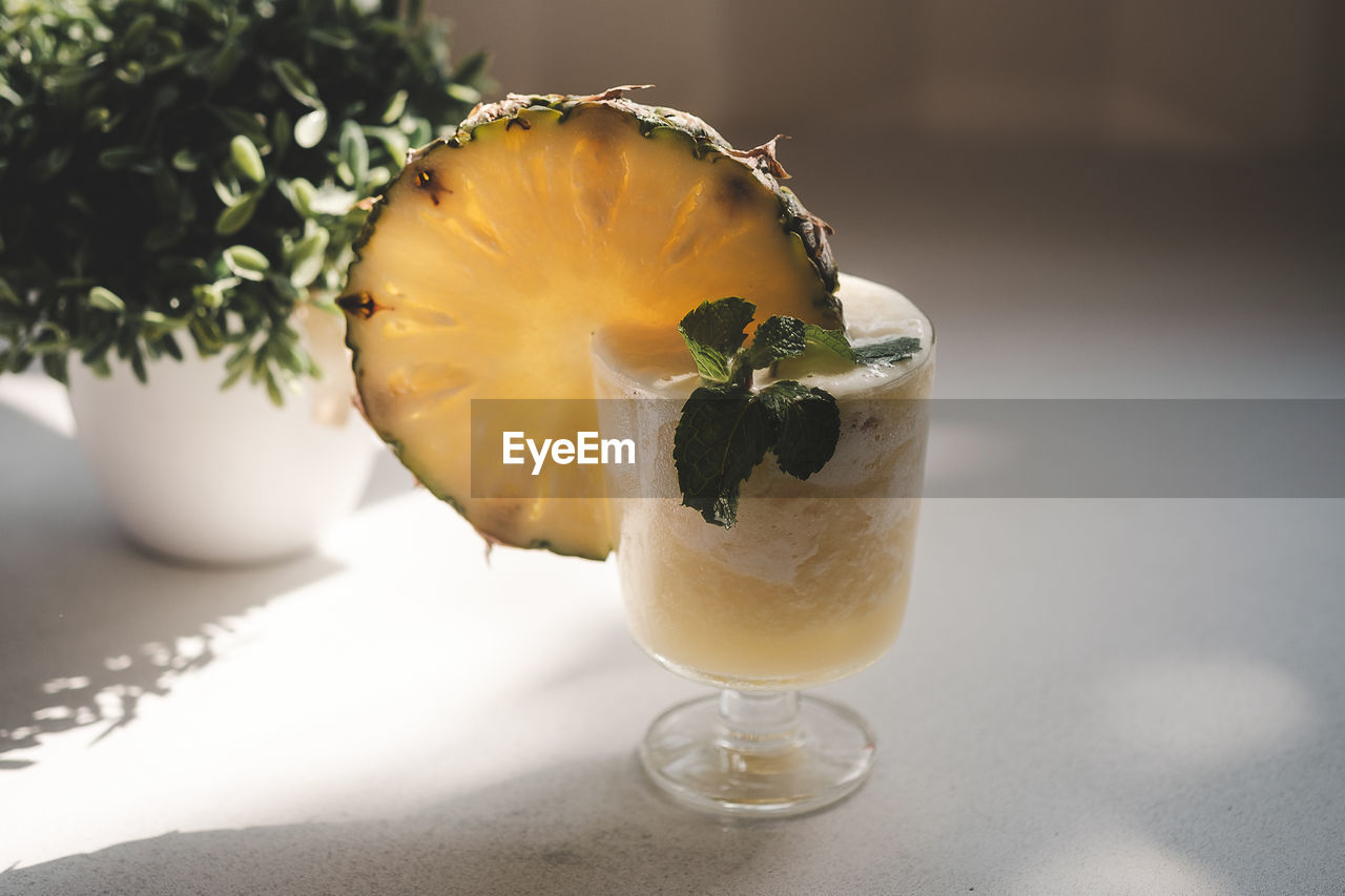 Close-up of cocktail in glass on table