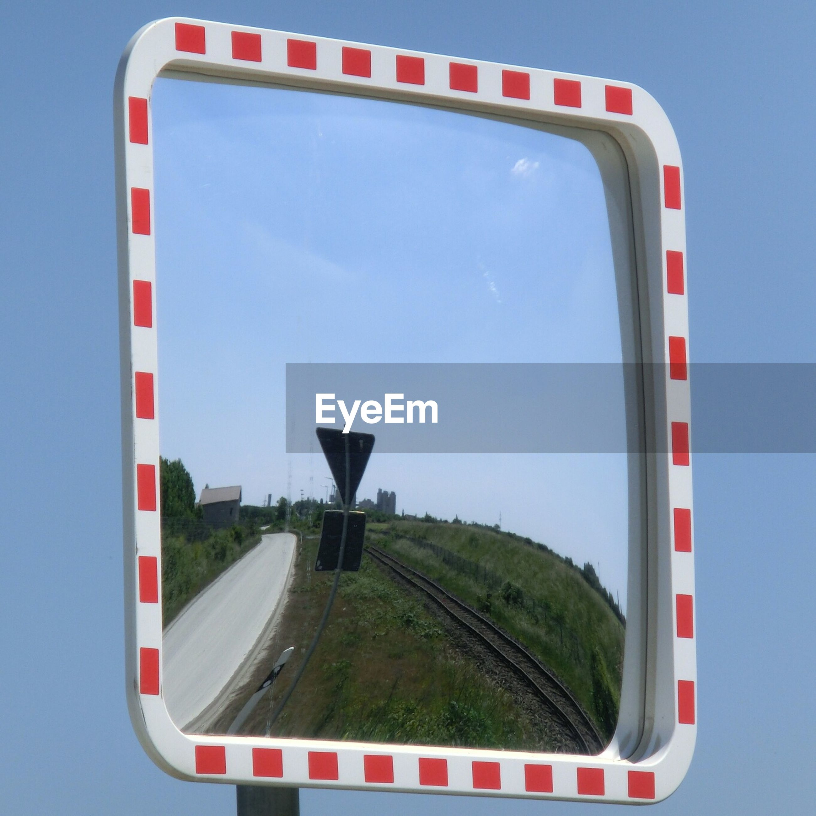 Reflection of empty road in mirror