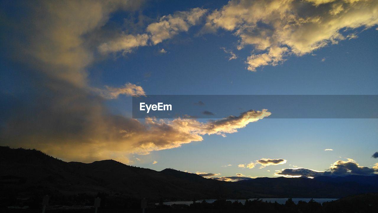 sky, cloud - sky, scenics - nature, sunset, beauty in nature, tranquility, tranquil scene, mountain, nature, silhouette, environment, no people, landscape, outdoors, architecture, idyllic, mountain range, orange color, sunlight, built structure