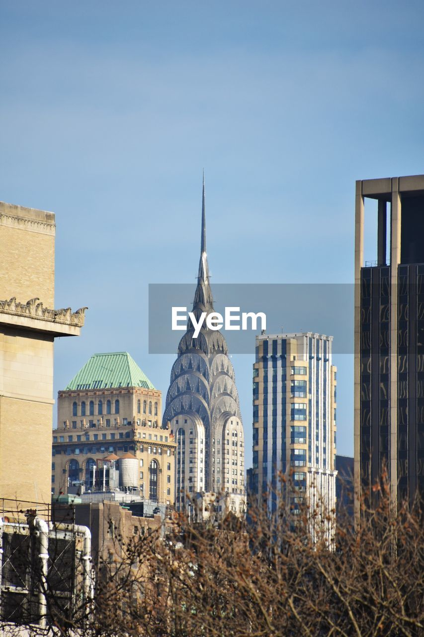 Panoramic view of buildings in city against clear sky