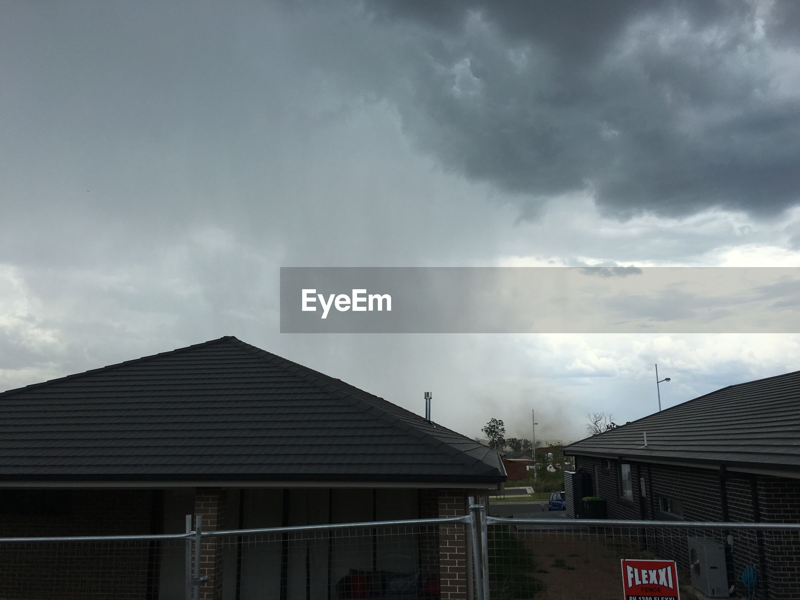 building exterior, sky, architecture, built structure, cloud - sky, cloudy, low angle view, cloud, overcast, weather, house, outdoors, building, city, storm cloud, roof, no people, high section, day, residential building