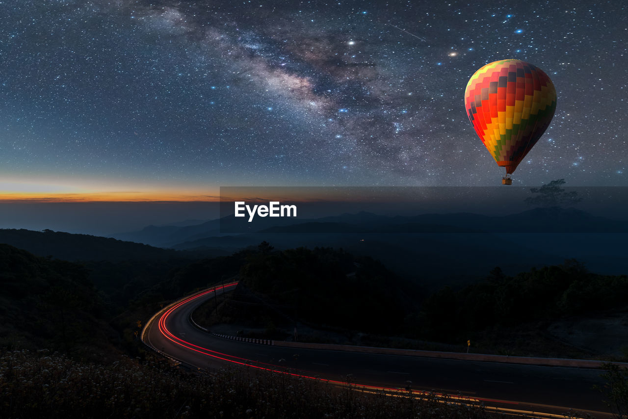 Aerial view of hot air balloon against sky at night