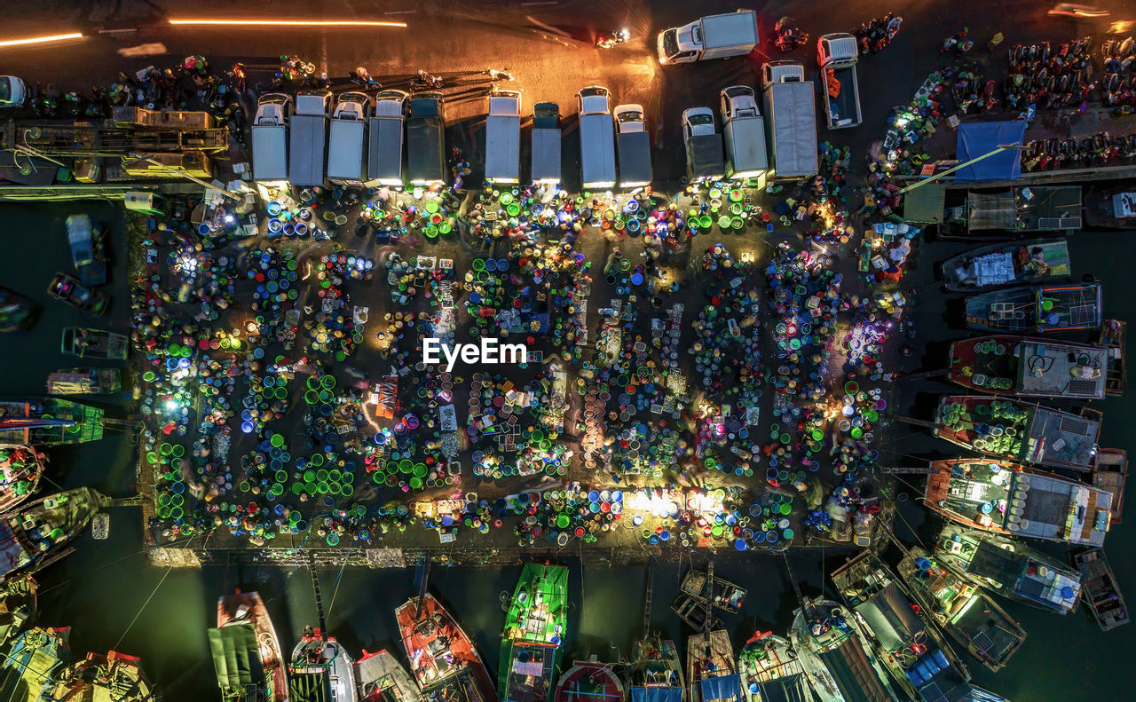 Aerial view of illuminated floating market at night