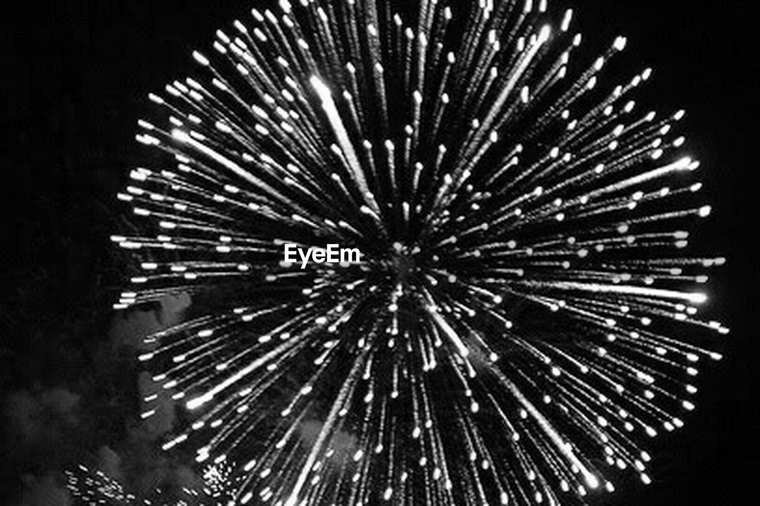 celebration, firework display, night, exploding, firework - man made object, arts culture and entertainment, event, low angle view, long exposure, blurred motion, illuminated, no people, outdoors, sky, black background