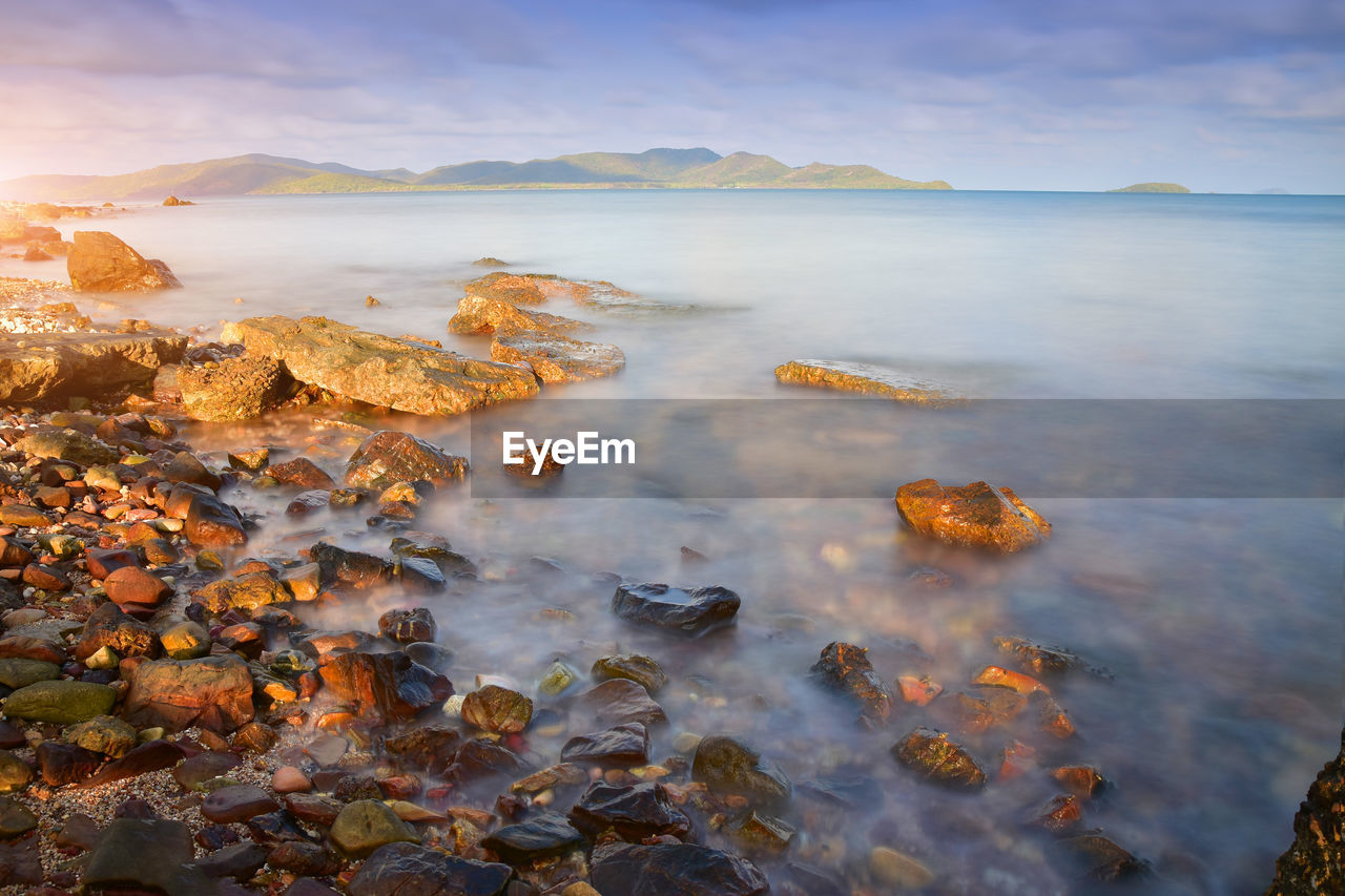water, beauty in nature, sky, tranquility, tranquil scene, scenics - nature, nature, no people, sea, cloud - sky, rock, non-urban scene, idyllic, day, mountain, solid, land, outdoors, rock - object