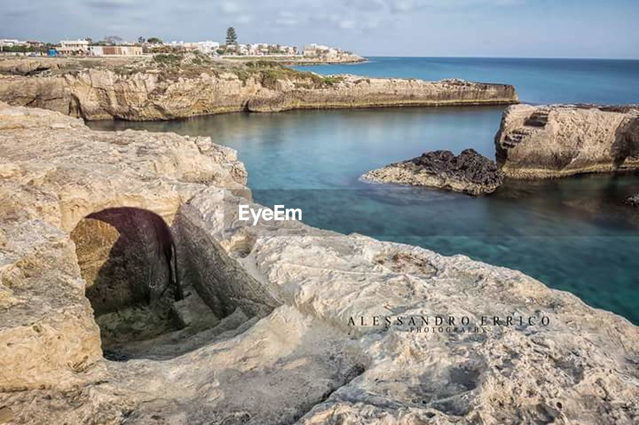 rock - object, sea, water, rock formation, day, nature, no people, scenics, rocky coastline, cliff, outdoors, sky, beauty in nature, horizon over water, architecture