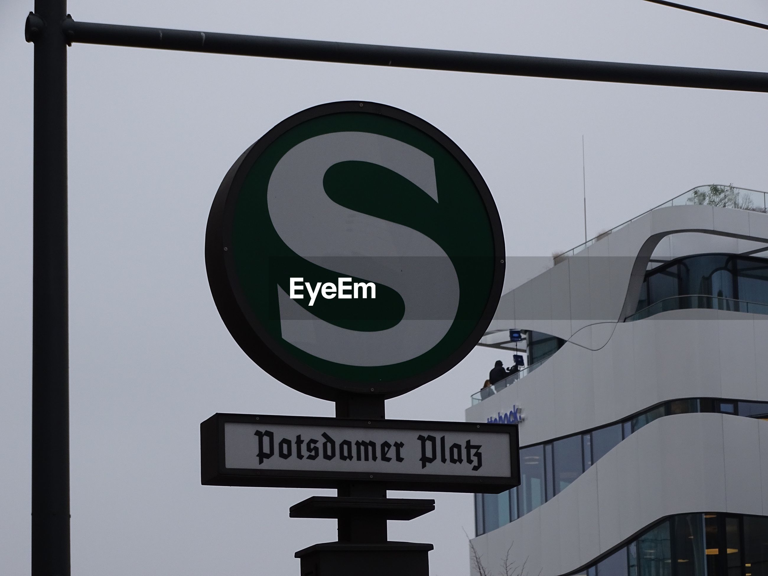 Low angle view of berlin s-bahn sign against sky