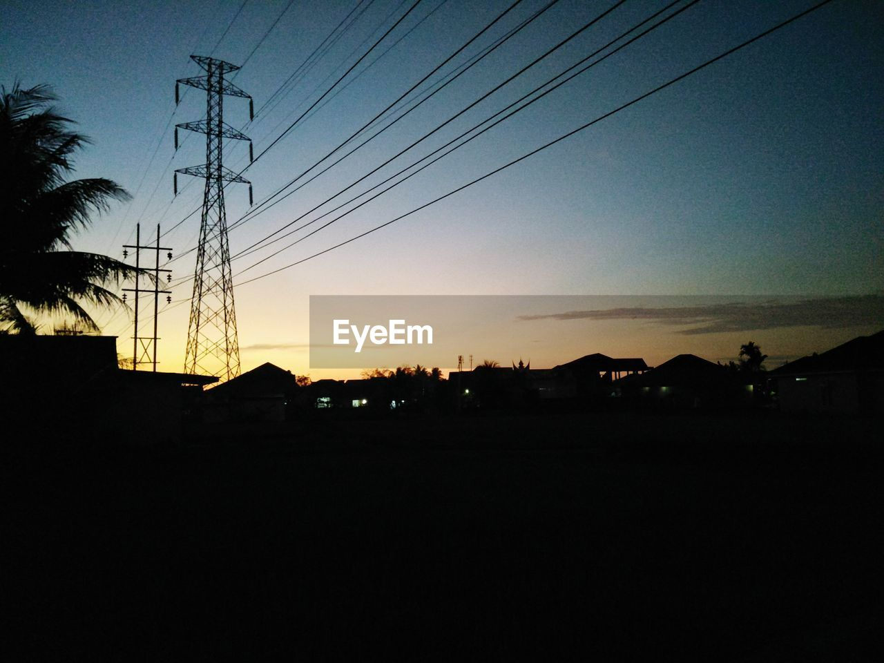 sky, electricity, cable, silhouette, technology, sunset, power line, electricity pylon, fuel and power generation, power supply, connection, no people, architecture, nature, built structure, copy space, building exterior, scenics - nature, landscape, tranquility, dark, outdoors, telephone line