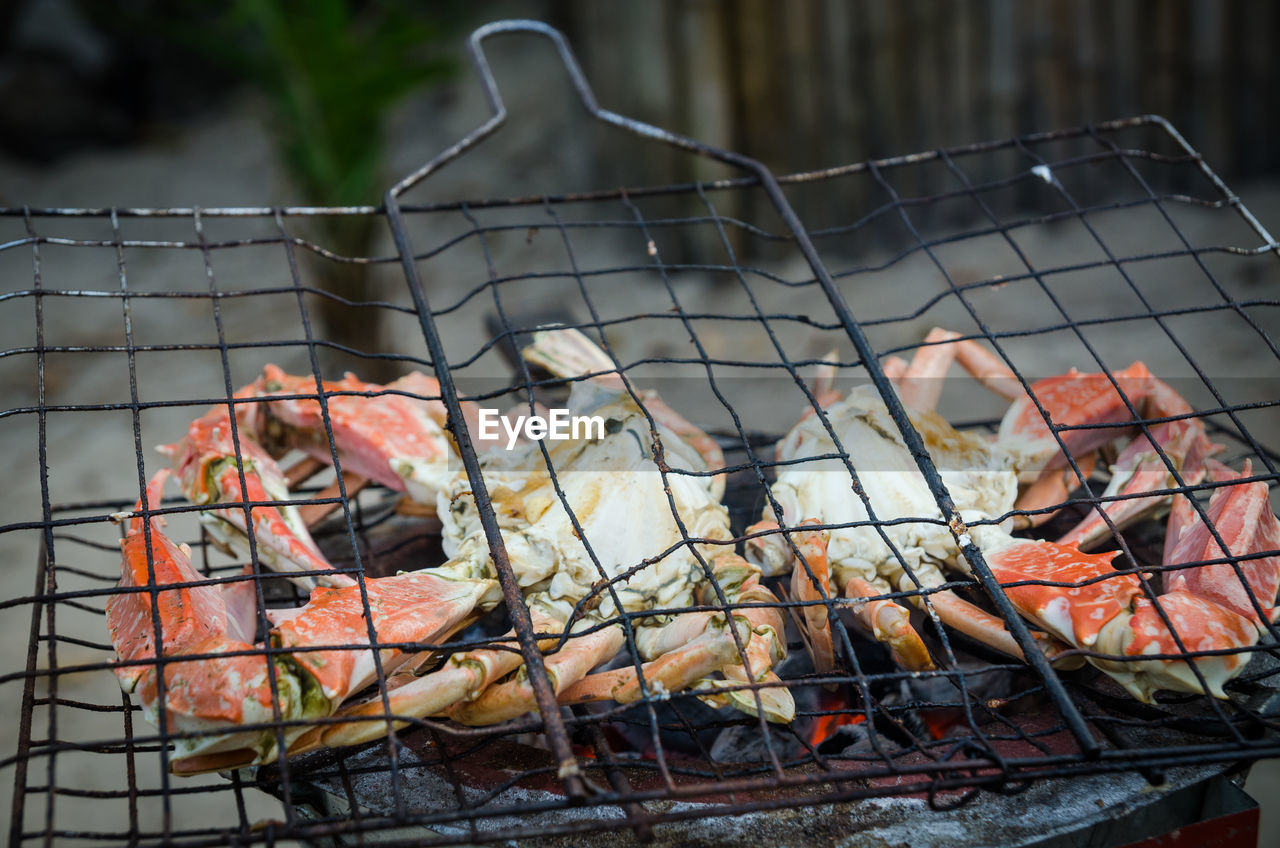 Close-up of crab meat on barbecue grill