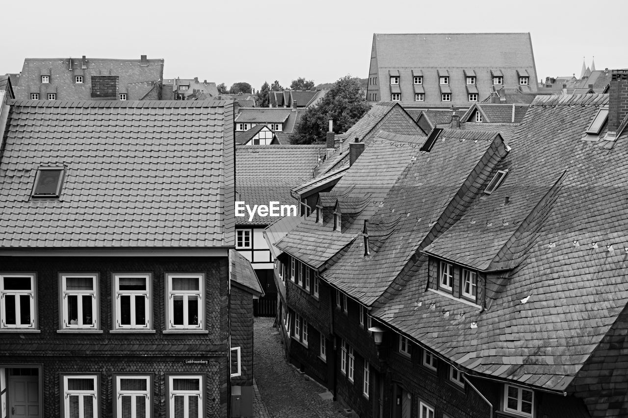 architecture, building exterior, built structure, building, city, residential district, roof, day, sky, window, no people, nature, clear sky, house, outdoors, roof tile, high angle view, the past, history