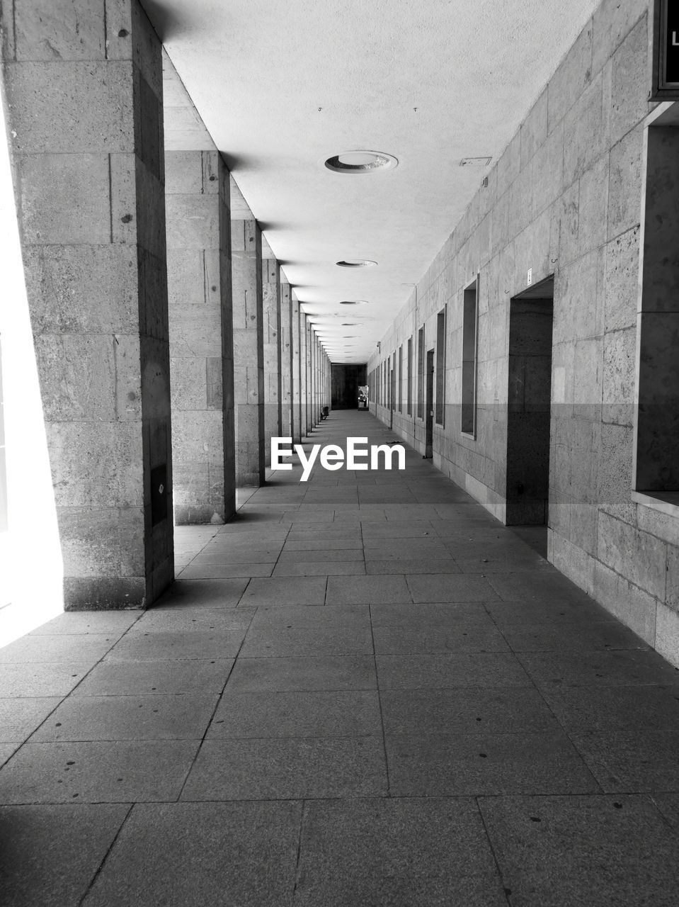 architecture, the way forward, direction, arcade, built structure, corridor, architectural column, building, diminishing perspective, in a row, indoors, ceiling, empty, flooring, no people, day, absence, vanishing point, wall - building feature, colonnade, paving stone, tiled floor