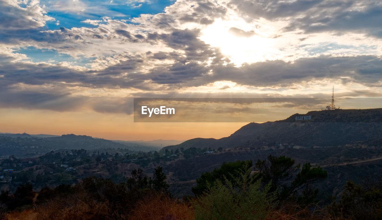 sky, cloud - sky, beauty in nature, mountain, scenics - nature, tranquility, tranquil scene, sunset, environment, landscape, nature, idyllic, non-urban scene, plant, mountain range, no people, tree, orange color, outdoors, sunlight, mountain peak