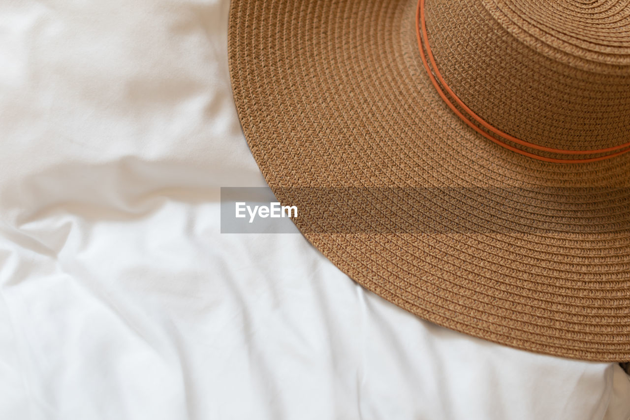 High angle view of hat on bed at home