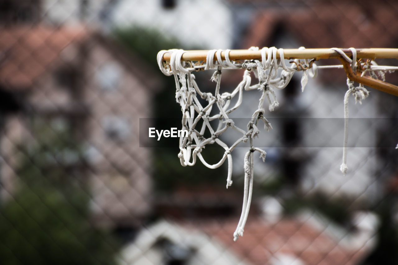 focus on foreground, close-up, no people, metal, day, outdoors, hanging, nature, selective focus, water, drop, chain, frozen, ice, cold temperature, tranquility, winter, religion, icicle