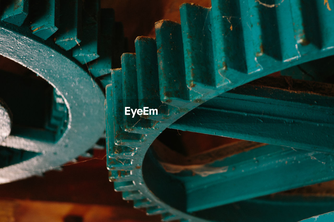 metal, machinery, close-up, no people, gear, machine part, equipment, indoors, pattern, industry, focus on foreground, green color, full frame, backgrounds, connection, shape, rusty, technology, old, wheel, metal industry, turquoise colored, alloy, industrial equipment