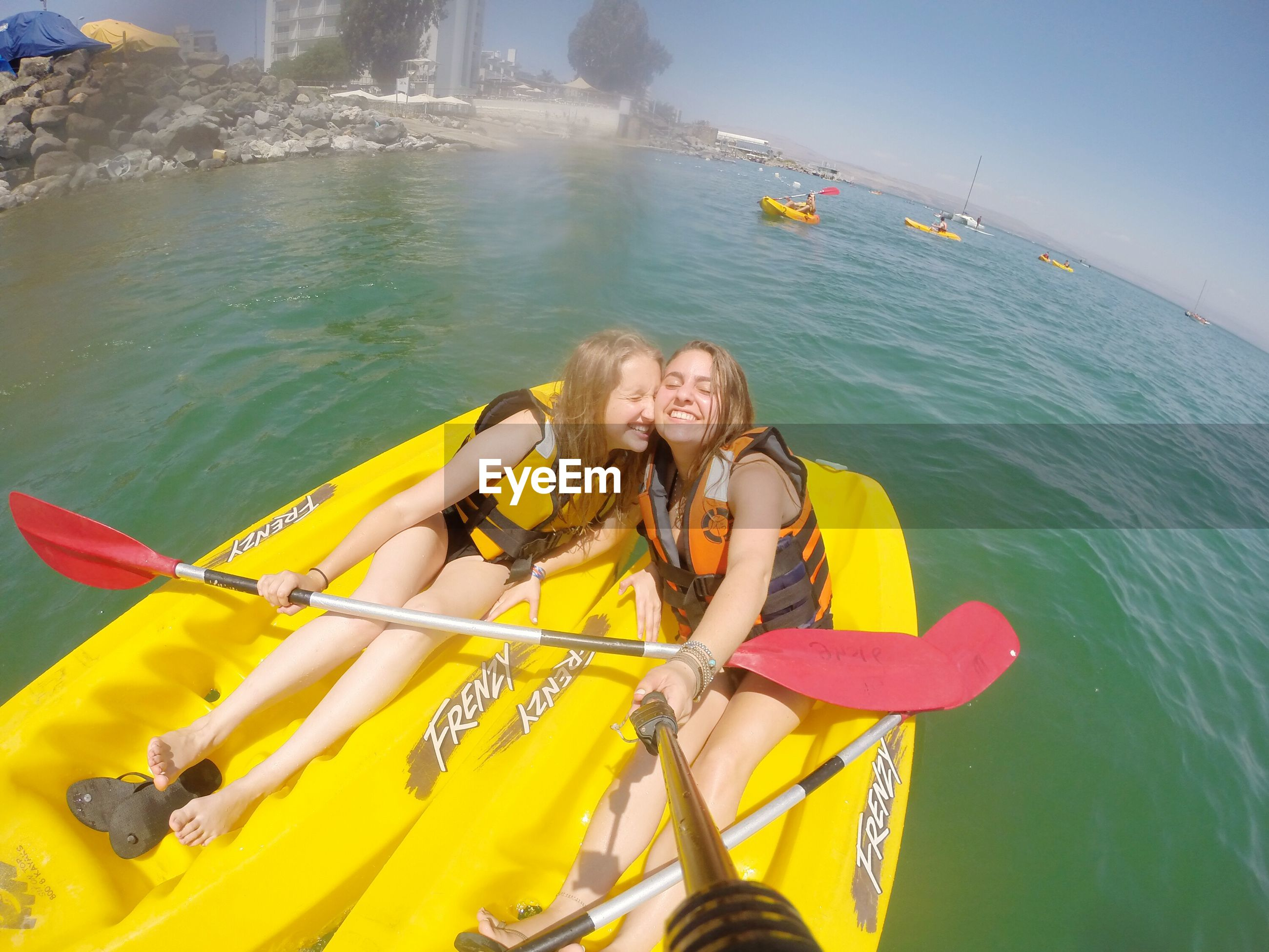 leisure activity, lifestyles, water, transportation, enjoyment, person, mode of transport, holding, vacations, fun, nautical vessel, young adult, sea, full length, boat, oar, happiness