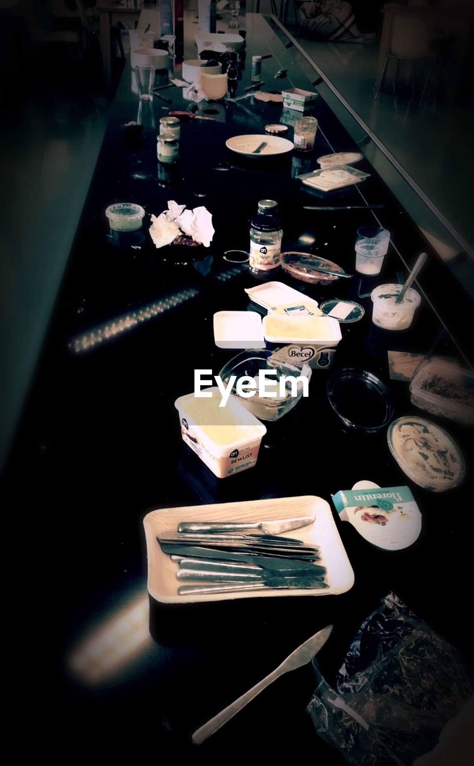 indoors, table, still life, high angle view, large group of objects, variation, arrangement, book, no people, close-up, absence, in a row, choice, food and drink, abundance, paper, chair, selective focus, wood - material, elevated view