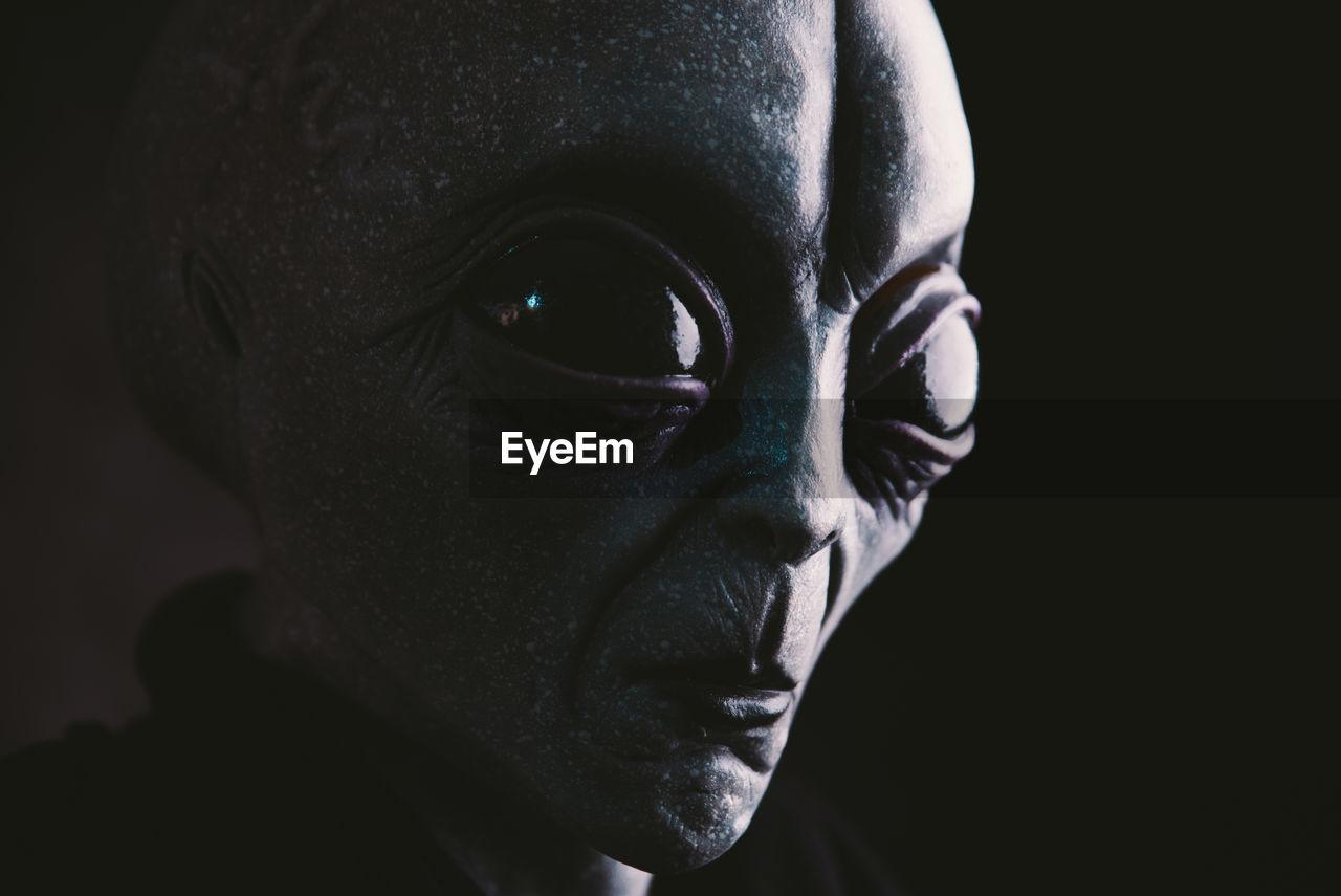 Close-up of alien against black background