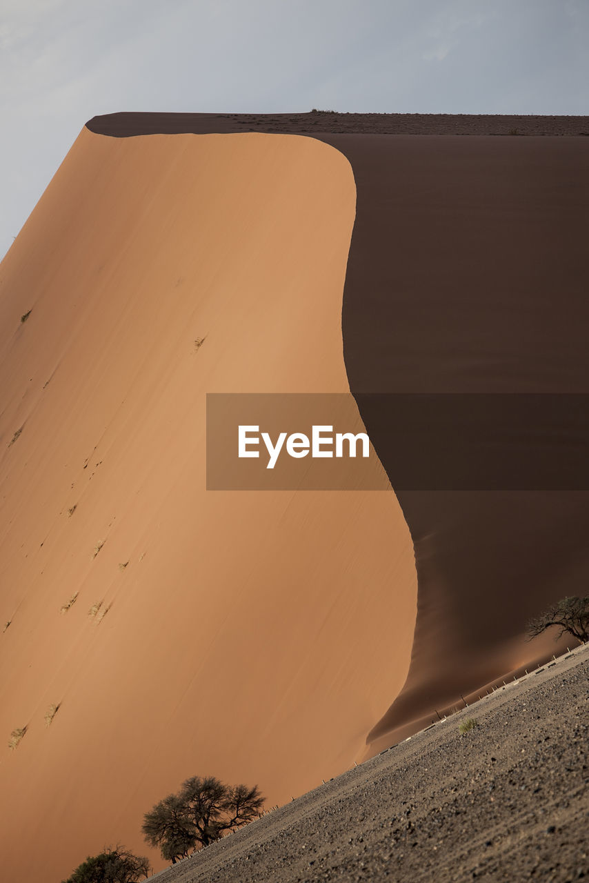 Idyllic View Of Sand Dune Against Sky
