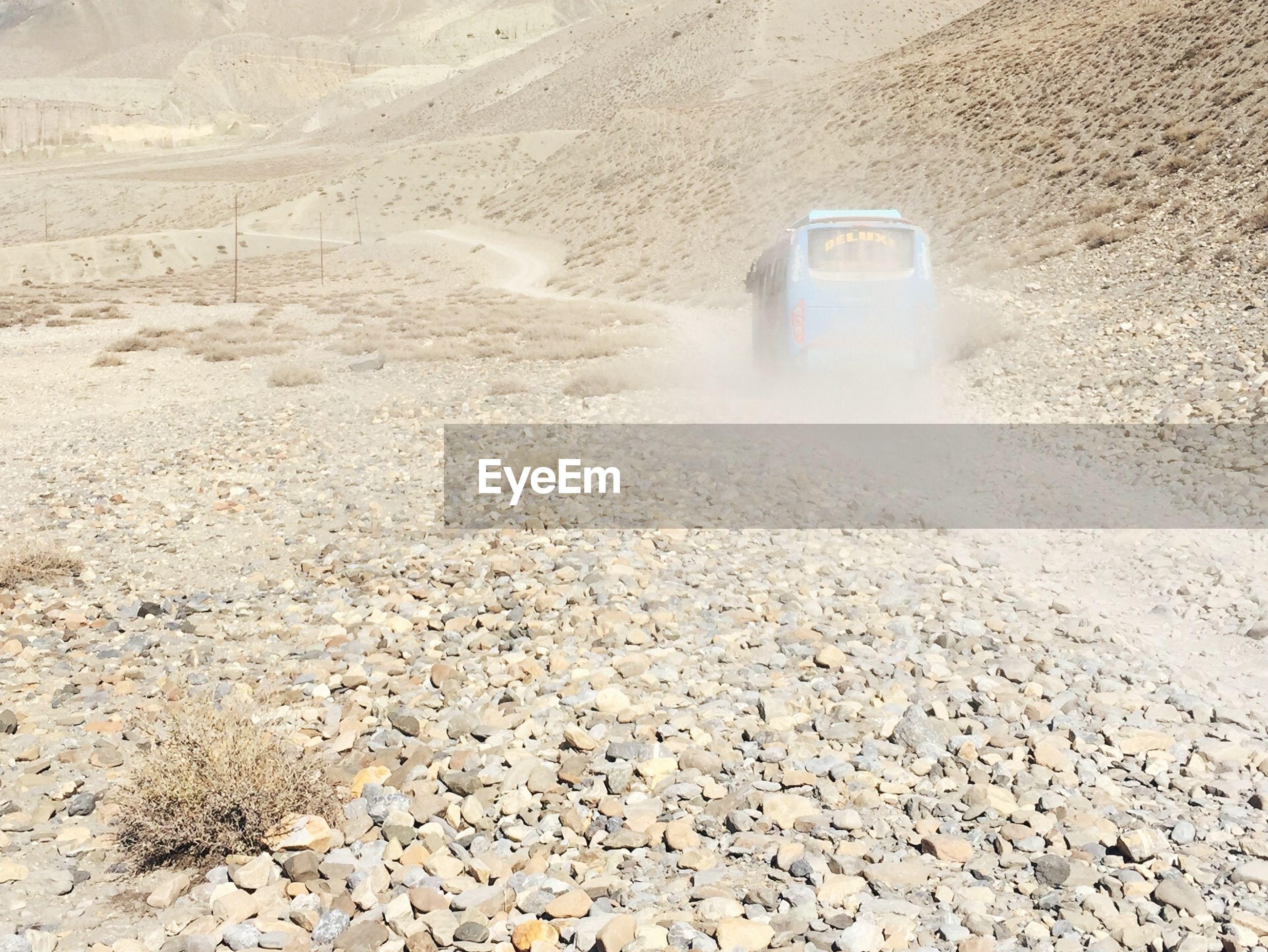 Bus on dirt road at annapurna range