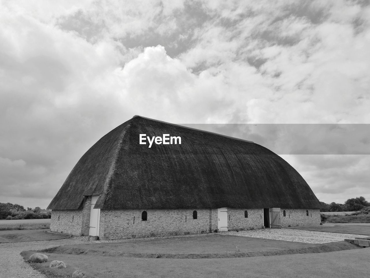 sky, cloud - sky, architecture, built structure, building exterior, land, nature, day, landscape, no people, field, building, outdoors, environment, roof, farm, agricultural building, thatched roof, barn, agriculture