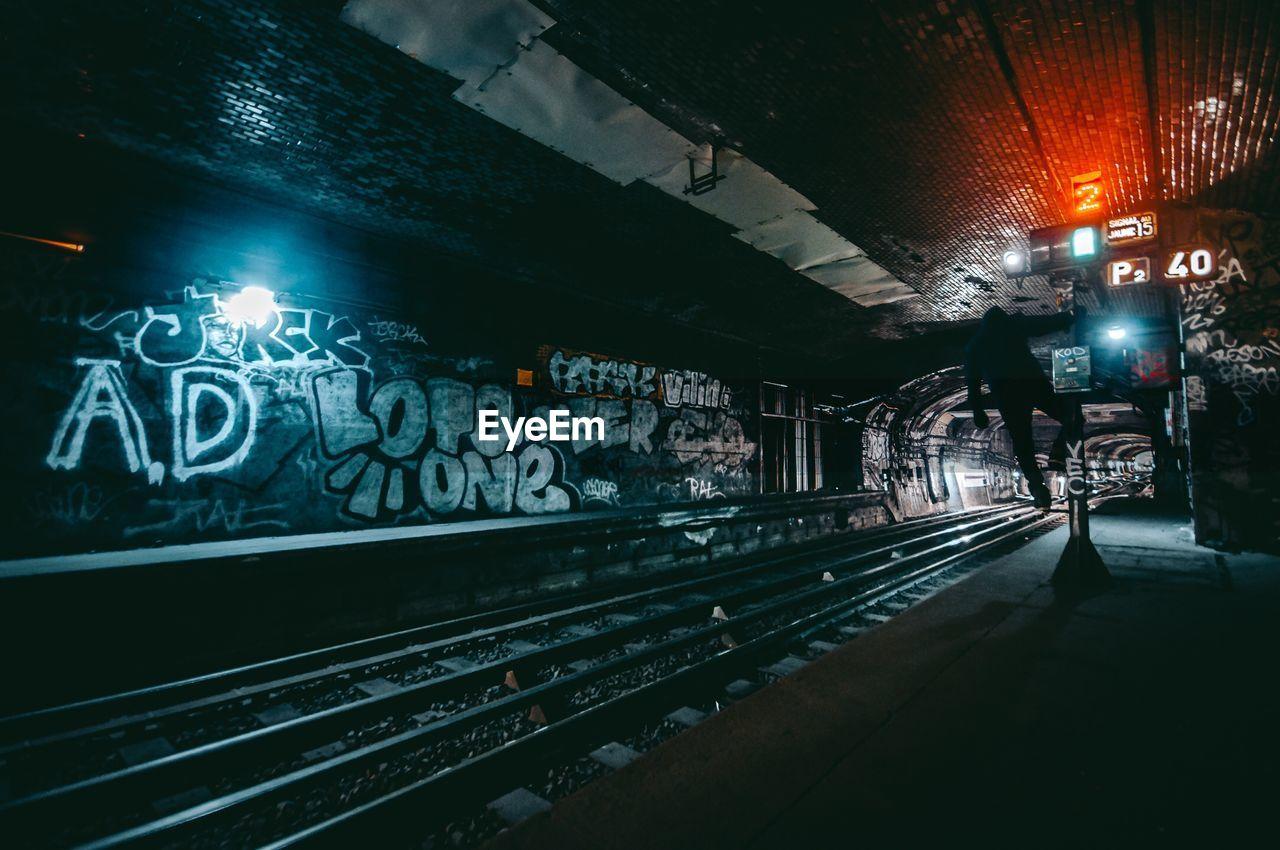 illuminated, night, text, rail transportation, railroad track, transportation, no people, built structure, indoors, architecture