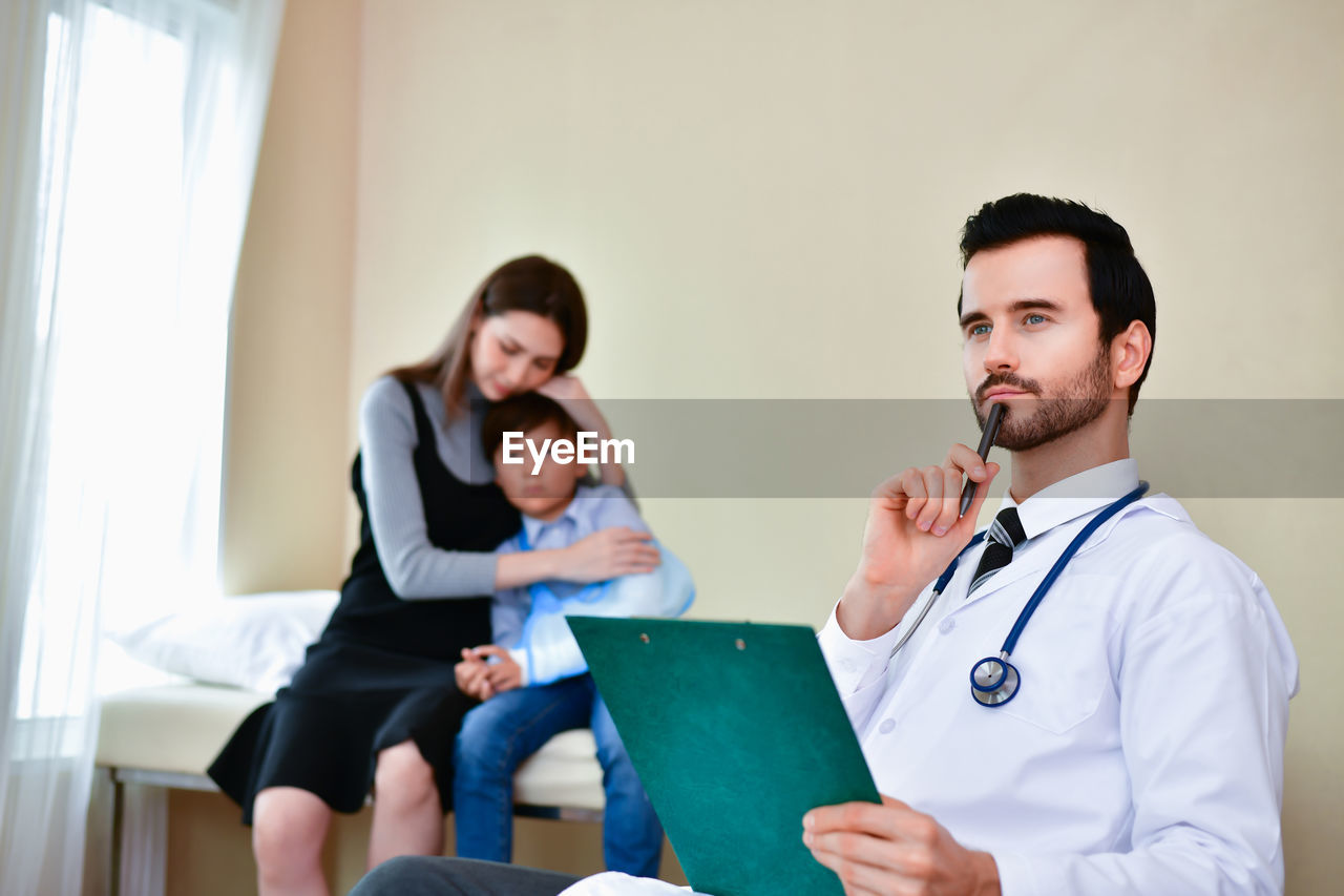 occupation, healthcare and medicine, stethoscope, adult, medical supplies, medical instrument, hospital, group of people, indoors, doctor, women, real people, lab coat, medical equipment, young adult, men, young men, females, focus on foreground, care