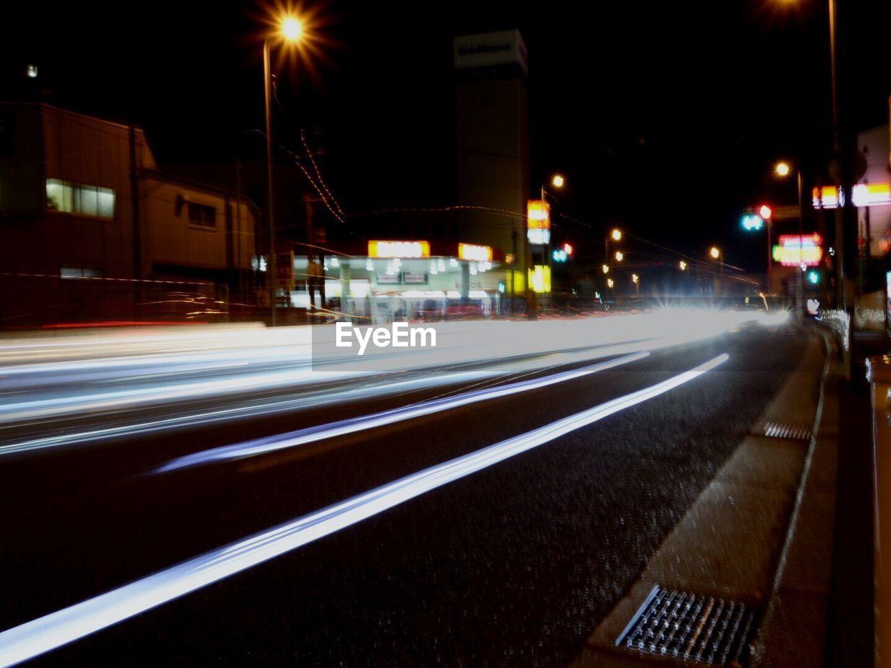 night, illuminated, long exposure, motion, speed, street, light trail, blurred motion, road, high street, street light, transportation, urban scene, no people, city, building exterior, outdoors, architecture