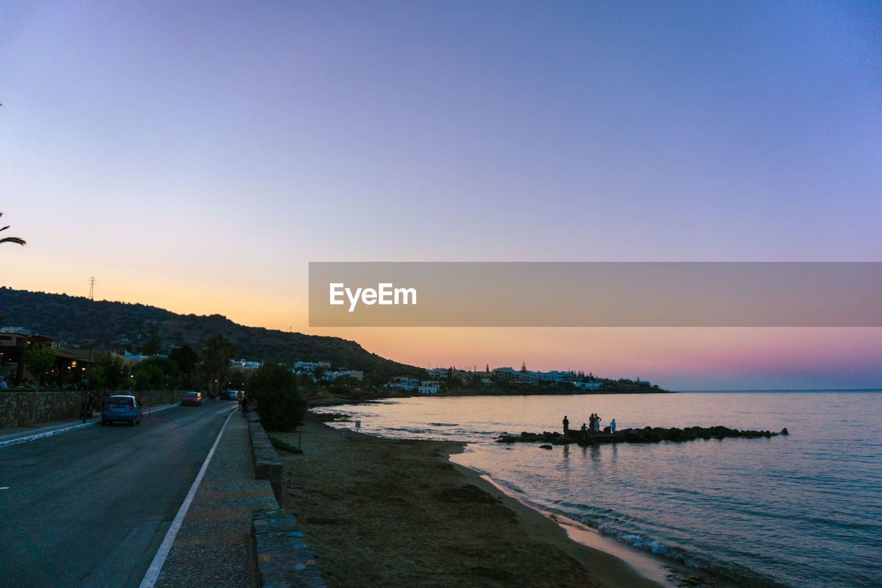 sunset, scenics, nature, sea, transportation, water, road, tranquil scene, beauty in nature, tranquility, outdoors, clear sky, sky, mountain, no people, day