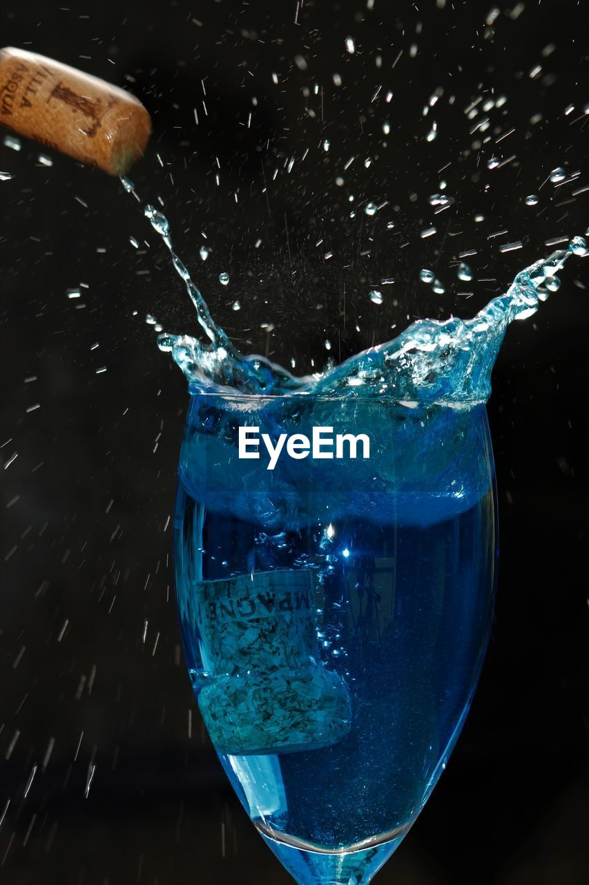 glass, water, refreshment, drink, close-up, food and drink, household equipment, blue, motion, transparent, drinking glass, splashing, no people, indoors, glass - material, freshness, nature, bubble, pouring, purity, flowing water